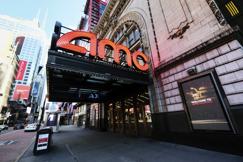 FILE - The AMC Empire 25 theatre appears on 42nd Street on May 13, 2020, in New York. Movie theaters in New York City reopen Friday. (Photo by Evan Ag...