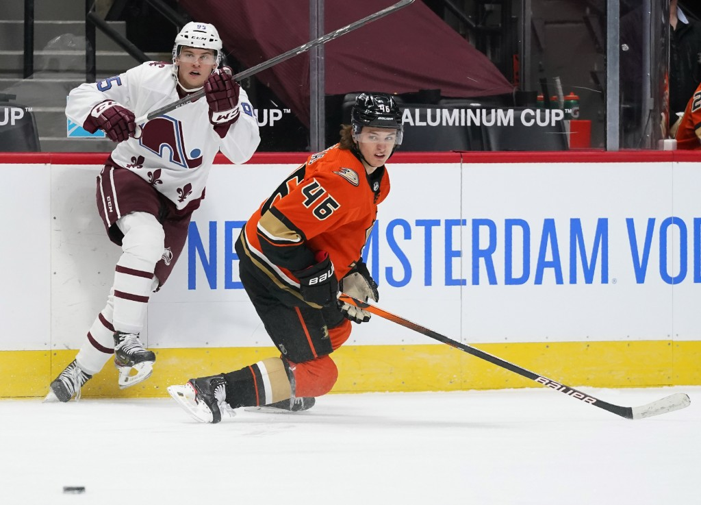 Colorado Avalanche left wing Andre Burakovsky, left, pursues the puck with Anaheim Ducks center Trevor Zegras in the first period of an NHL hockey gam...