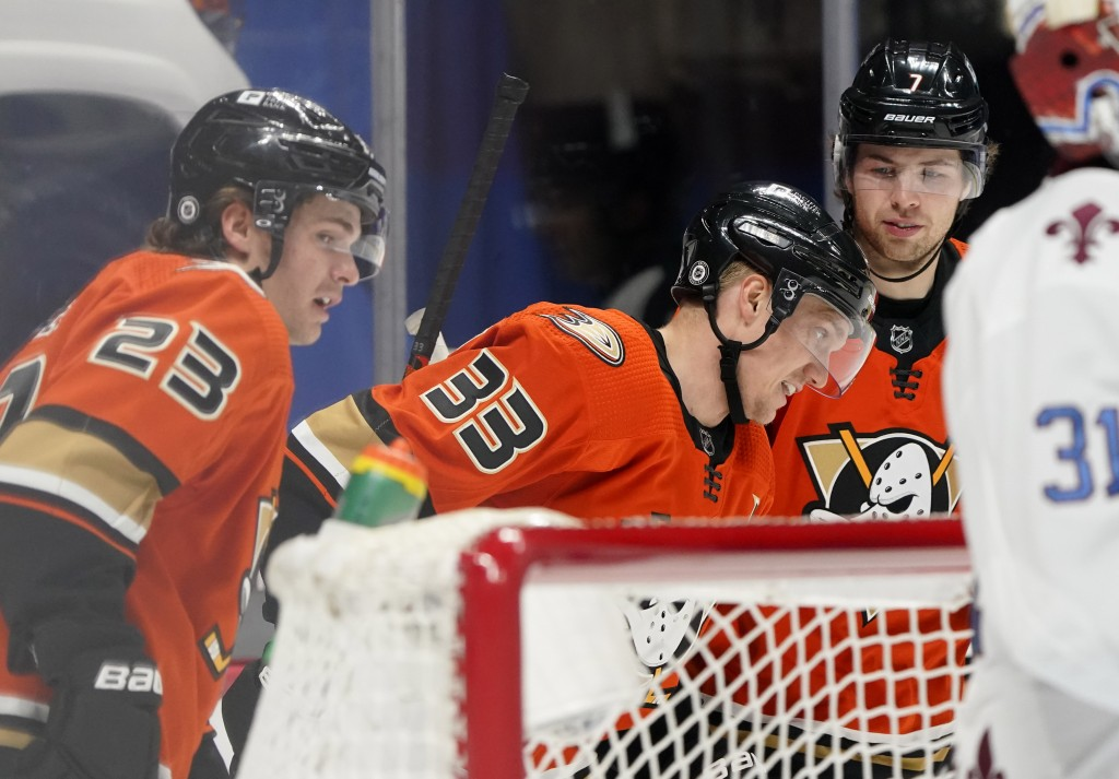 Anaheim Ducks right wing Jakob Silfverberg, center, celebrates after scoring a goal with center Sam Steel, left, and defenseman Ben Hutton in the seco...