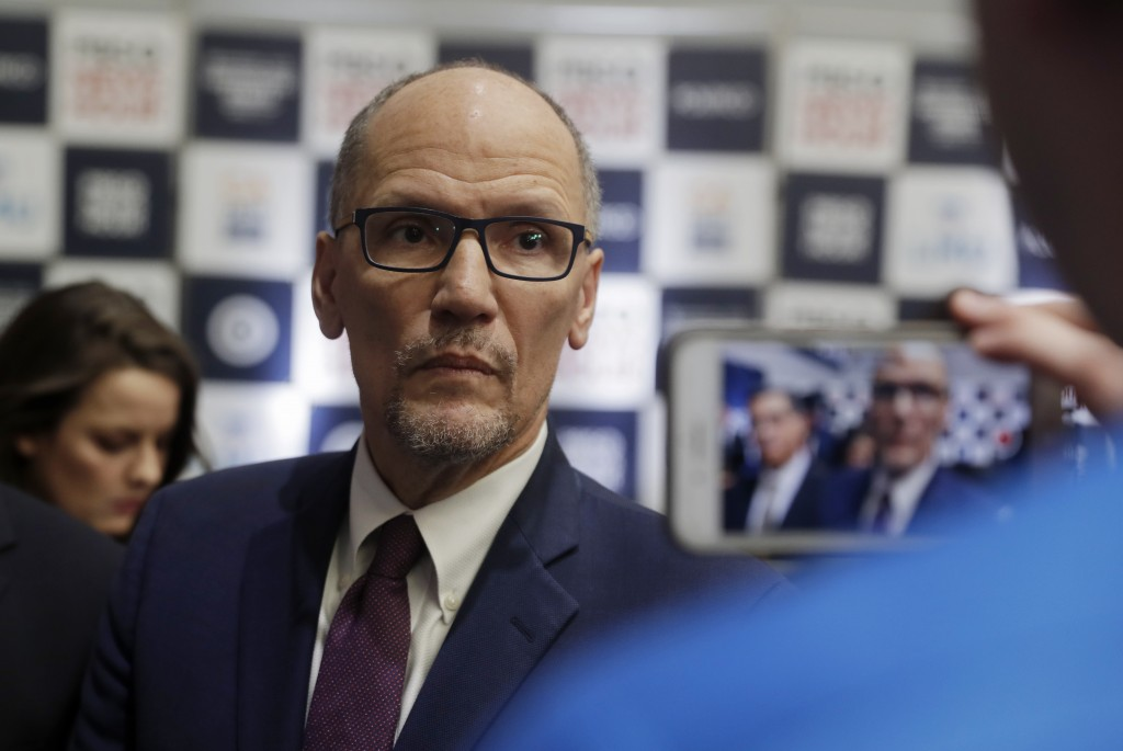 FILE - In this Dec. 19, 2019, file photo Democratic National Committee chairman Tom Perez is recorded on a phone before a Democratic presidential prim...