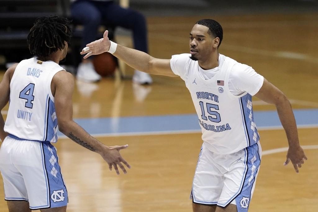 North Carolina guard R.J. Davis (4) congratulates forward Garrison Brooks (15) following Brooks' basket against Duke during the second half of an NCAA...