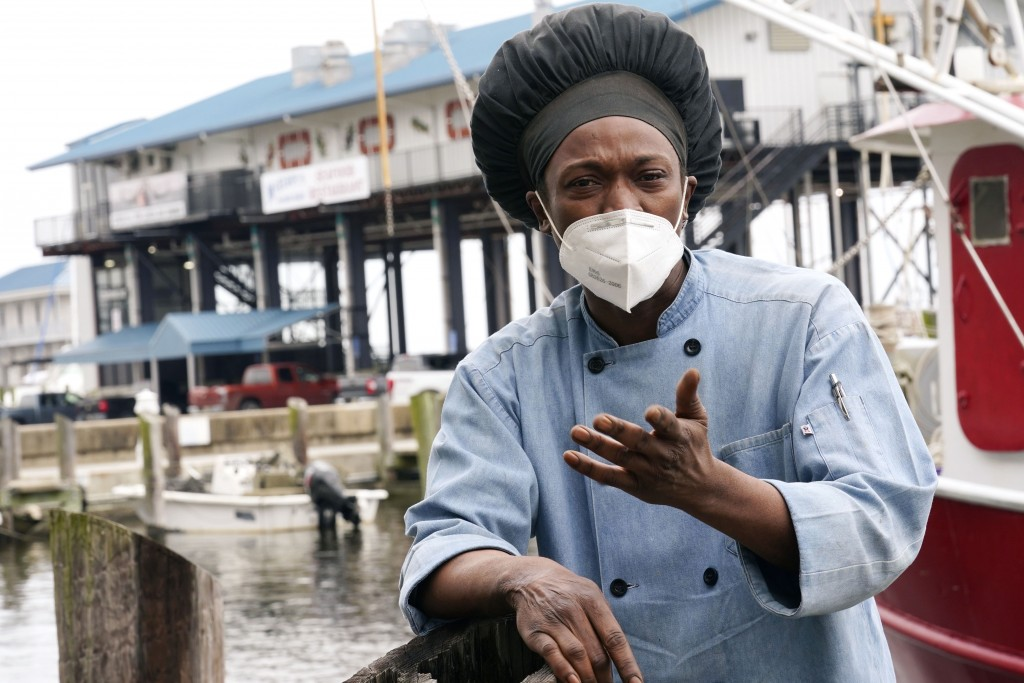 Leo Carney, kitchen manager at McElroy's Harbor House in Biloxi on the Mississippi Gulf Coast, stands along the dock at the city's small craft harbor ...