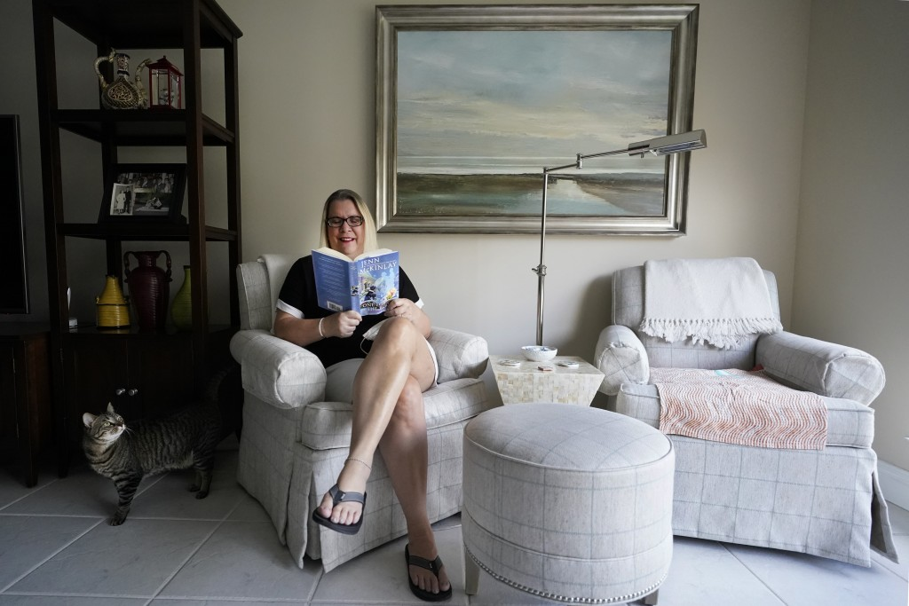 Kelly Vaiman poses for a photo in her living room where she sometimes likes to sit and read, Friday, Feb. 19, 2021, in Boynton Beach, Fla. Vaiman is a...