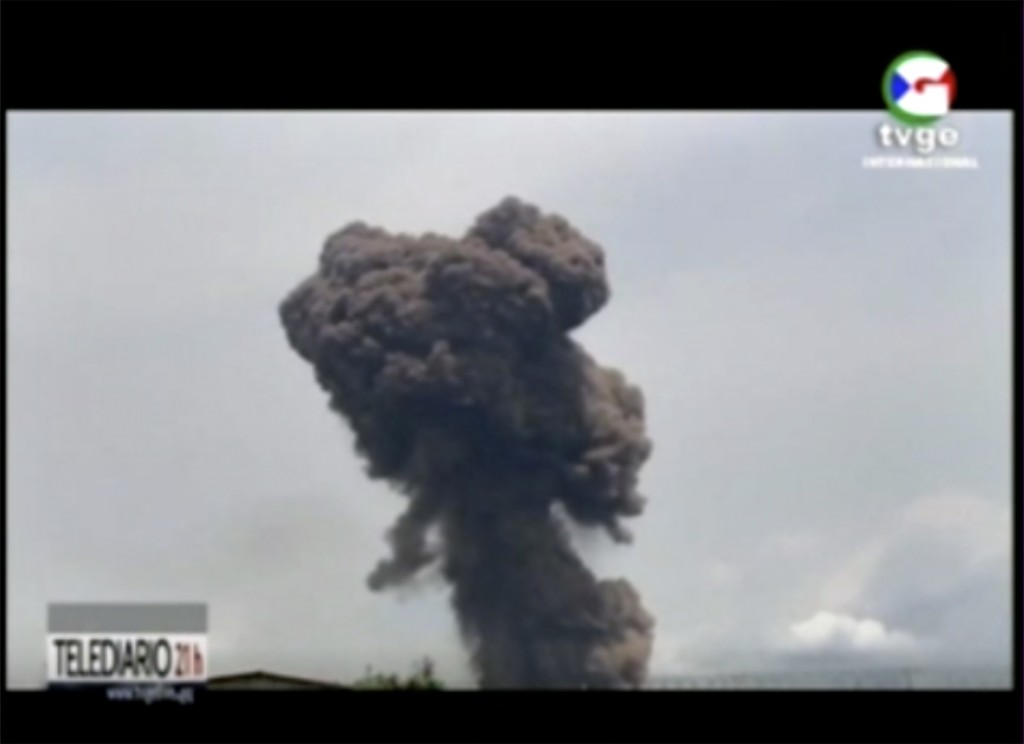 This TVGE image made from video shows smoke rising over the blast site at a military barracks in Bata, Equatorial Guinea, Sunday, March 7, 2021. A ser...