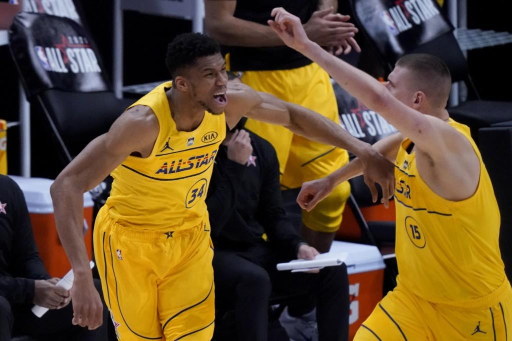 Milwaukee Bucks forward Giannis Antetokounmpo celebrates with Denver Nuggets center Nikola Jokic during the first half of basketball's NBA All-Star Ga...