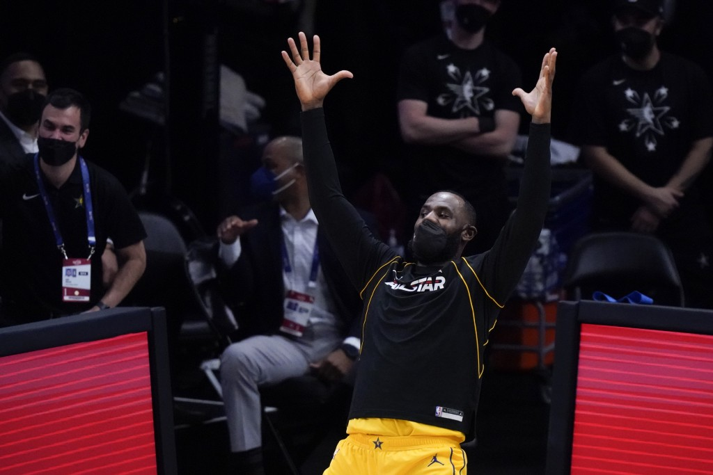 Los Angeles Lakers forward LeBron James celebrates during the first half of basketball's NBA All-Star Game in Atlanta, Sunday, March 7, 2021. (AP Phot...