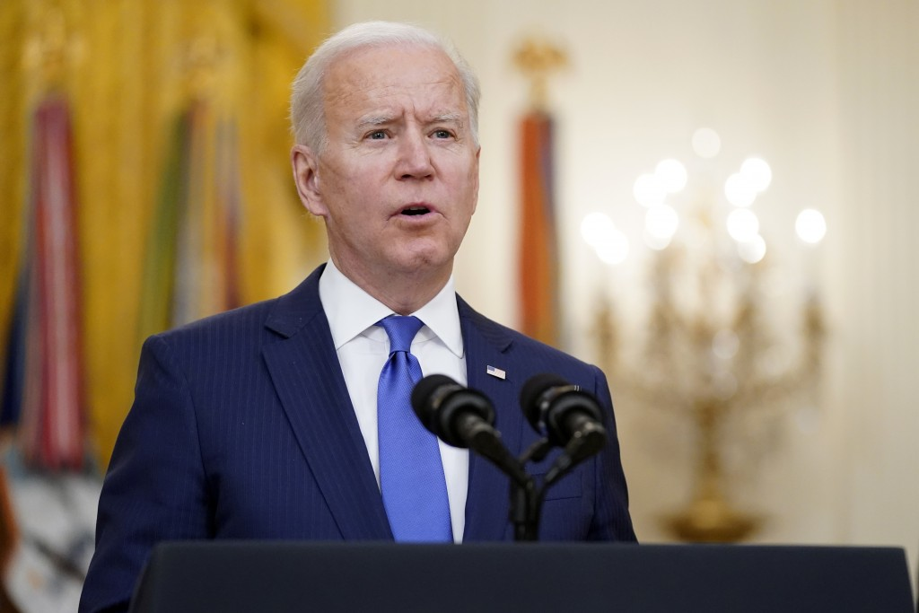 President Joe Biden speaks during an event to mark International Women's Day, Monday, March 8, 2021, in the East Room of the White House in Washington...