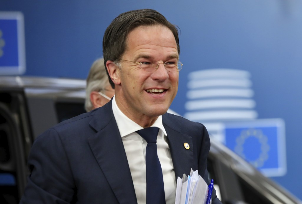 FILE - In this file photo dated Saturday, July 18, 2020, Dutch Prime Minister Mark Rutte arrives for an EU summit at the European Council building in ...
