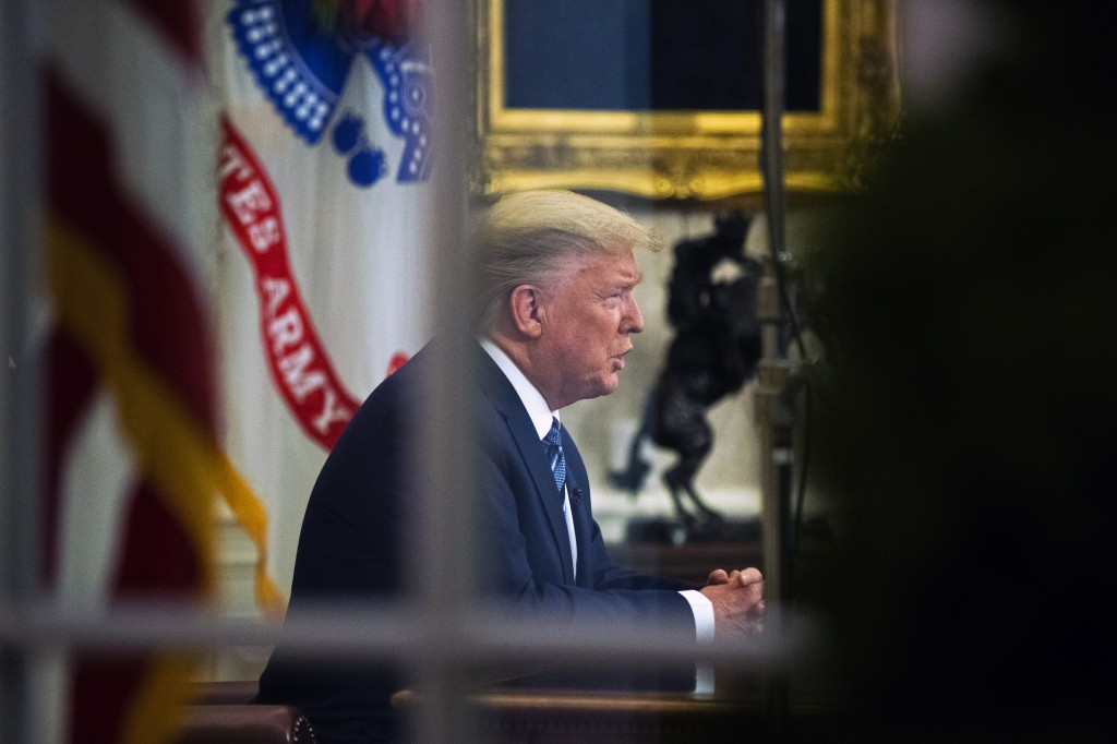 FILE - In this March 11, 2020, file photo, President Donald Trump addresses the nation from the Oval Office about the coronavirus outbreak at the Whit...