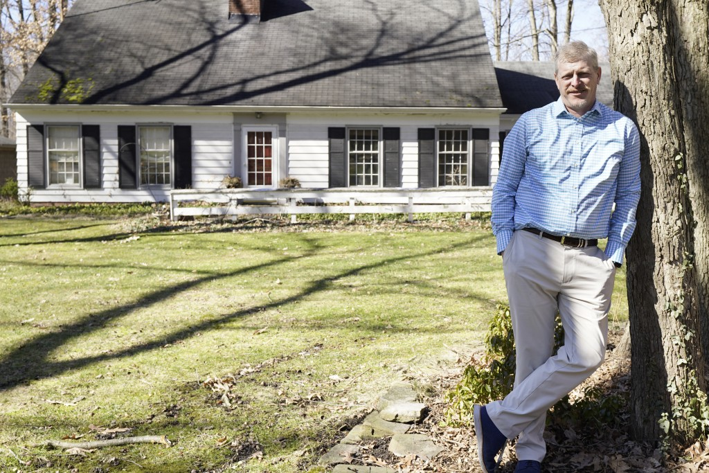 Matt Moorhead poses for a photo in front of his house, Tuesday, March 2, 2021, in Warren, Ohio. When General Motors ended a half-century of building c...