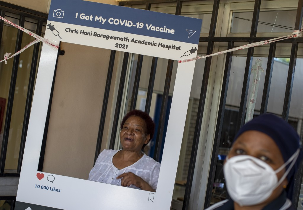 Maggie Sedidi, a 59-year-old nurse at Soweto's Chris Hani Baragwanath hospital, poses for a photo taken by a colleague after receiving her dose of the...