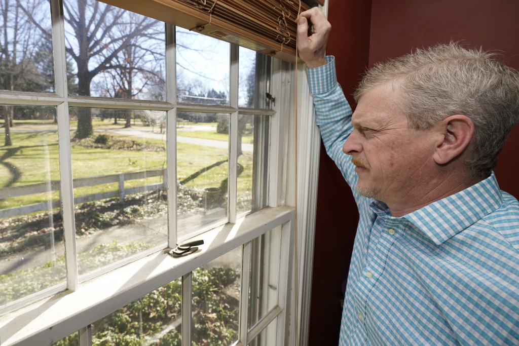 Matt Moorhead looks out his window Tuesday, March 2, 2021, in Warren, Ohio. When General Motors ended a half-century of building cars in Ohio's blue c...