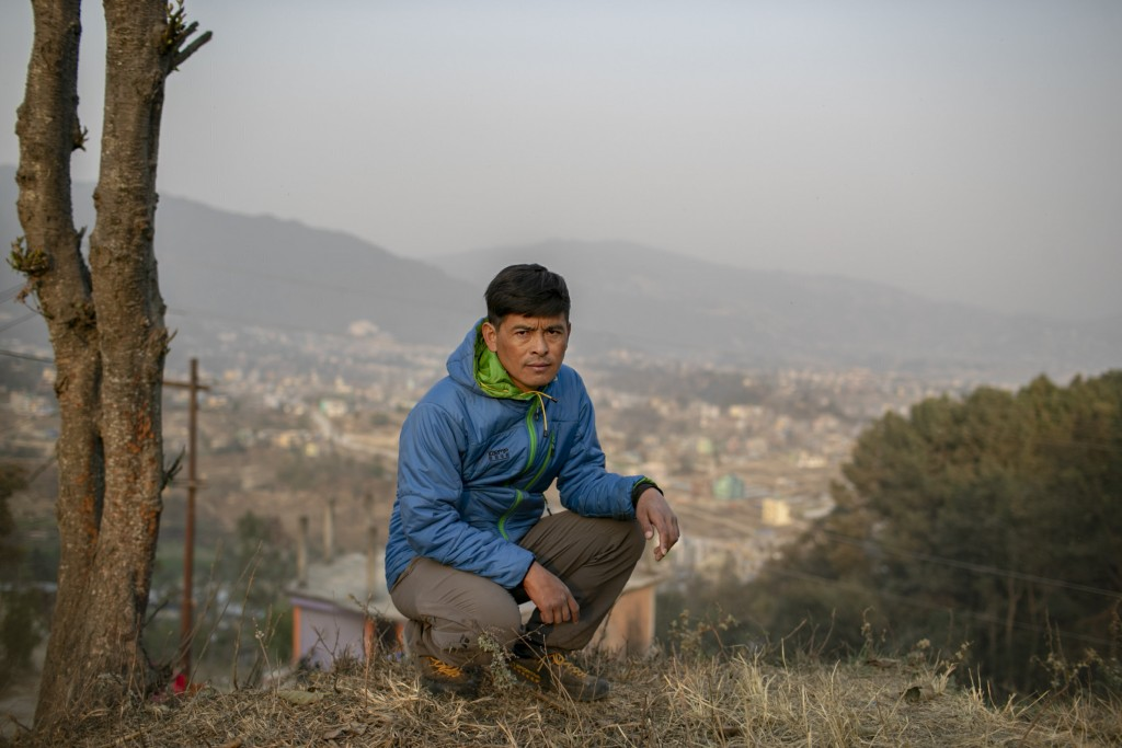Pasang Rinzee Sherpa, 33, mountain guide poses for a photograph in Kathmandu, Nepal, Wednesday, March 3, 2021. Sherpa has scaled Mount Everest twice a...