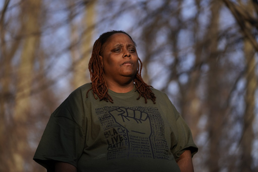 Latoria Glenn-Carr iposes for a photo in Westland, Mich.,Tuesday, March 9, 2021. Glenn-Carr and her wife of six years, Tyeisha, were diagnosed with co...