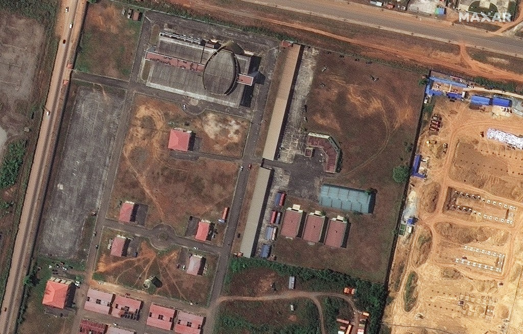 This handout satellite photo provided by Maxar Technologies shows the storage buildings before the explosion, in Bata, Equatorial Guinea, Aug. 7, 2020...