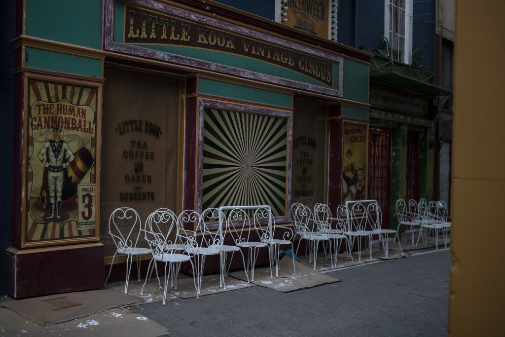 Painted white chairs stand outside a closed coffee shop, in Psiri district of Athens, on Tuesday, March 9, 2021.Greek authorities have announced a new...