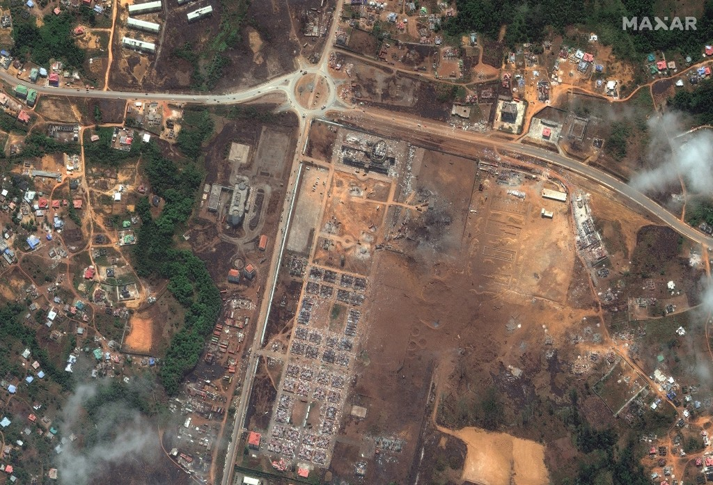 This handout satellite photo provided by Maxar Technologies shows a military garrison after an explosion, in Bata, Equatorial Guinea, Tuesday, March 9...