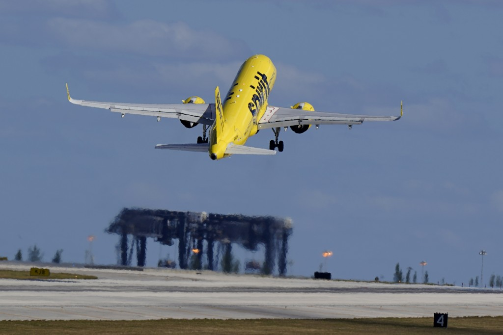 A Spirit Airlines Airbus A320 takes off from Fort Lauderdale-Hollywood International Airport, Tuesday, Jan. 19, 2021, in Fort Lauderdale, Fla.  Invest...