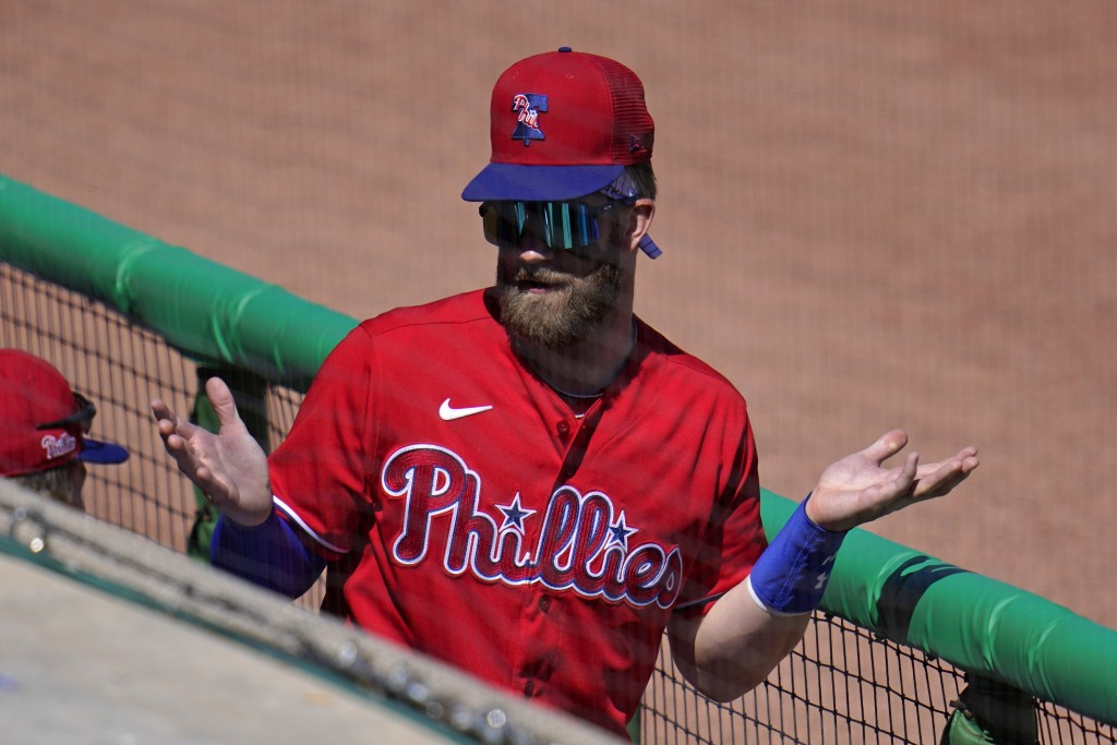 Philadelphia Phillies' Bryce Harper gestures in the dugout during a spring training exhibition baseball game against the Detroit Tigers in Clearwater,...