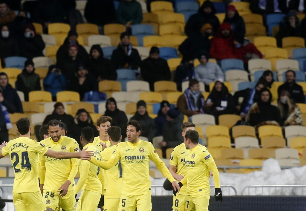 Villareal's Pau Torres celebrates with teammates after scoring his side's opening goal during the Europa League round of 16 first leg soccer match bet...