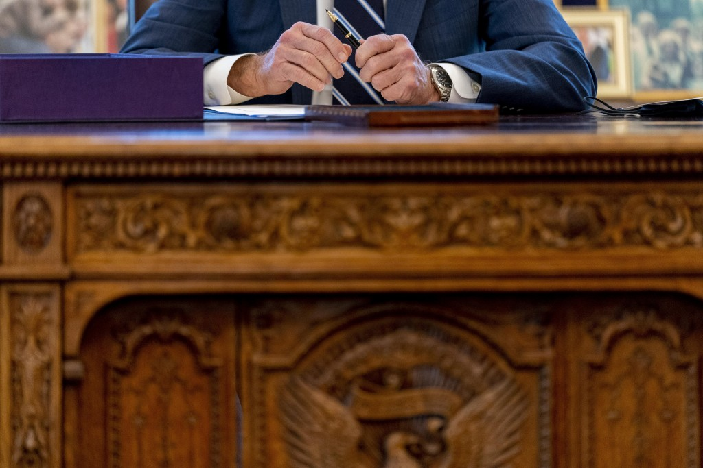 President Joe Biden speaks before signing the American Rescue Plan, a coronavirus relief package, in the Oval Office of the White House, Thursday, Mar...
