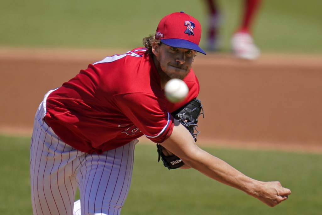 Philadelphia Phillies starting pitcher Aaron Nola delivers during the first inning of a spring training baseball game against the New York Yankees in ...