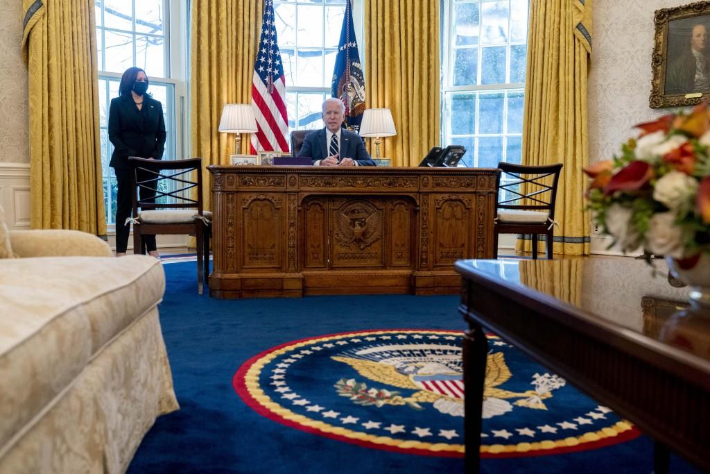 President Joe Biden, accompanied by Vice President Kamala Harris, speaks before signing the American Rescue Plan, a coronavirus relief package, in the...