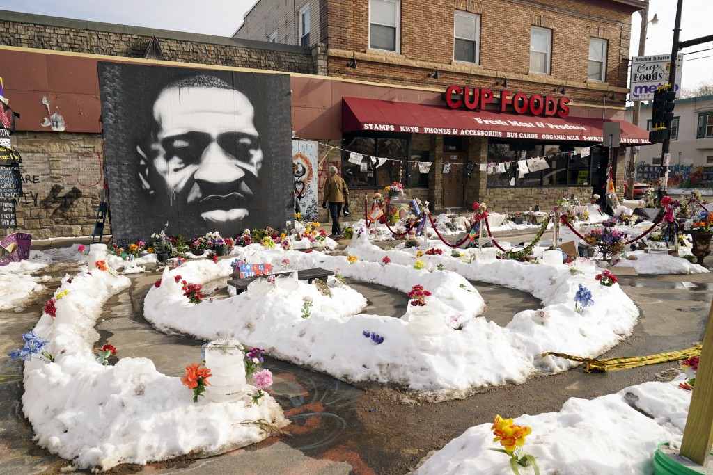 FILE - In this Feb. 8, 2021 file photo, A mural of George Floyd is seen in George Floyd Square in Minneapolis. The city of Minneapolis on Friday, Marc...