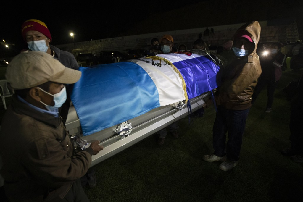 Relatives carry the remains of Guatemalan migrants who were killed near the U.S.-Mexico border in January, at a memorial Mass in a soccer stadium in C...