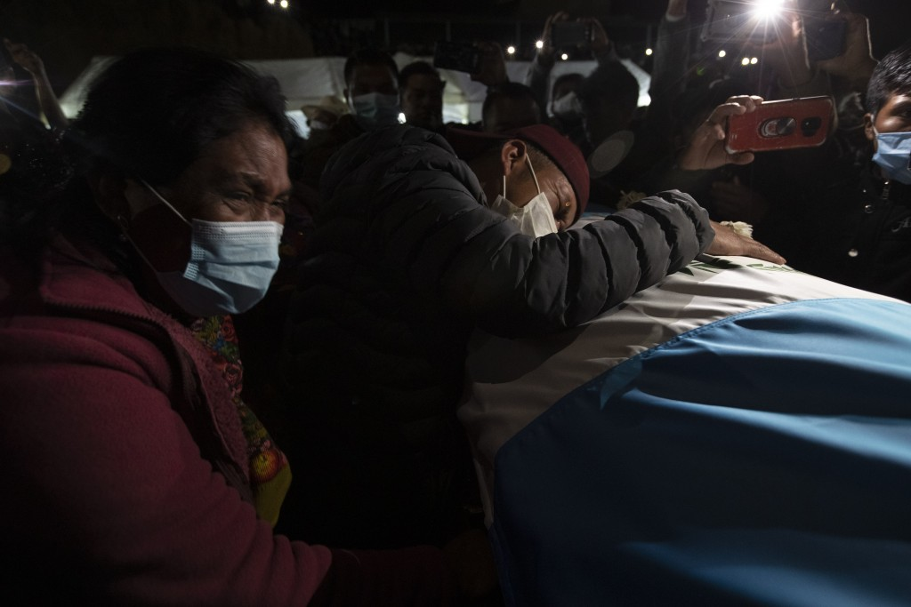 Relatives attend a memorial Mass for the Guatemalan migrants who were killed near the U.S.-Mexico border in January, at a soccer stadium in Comitancil...