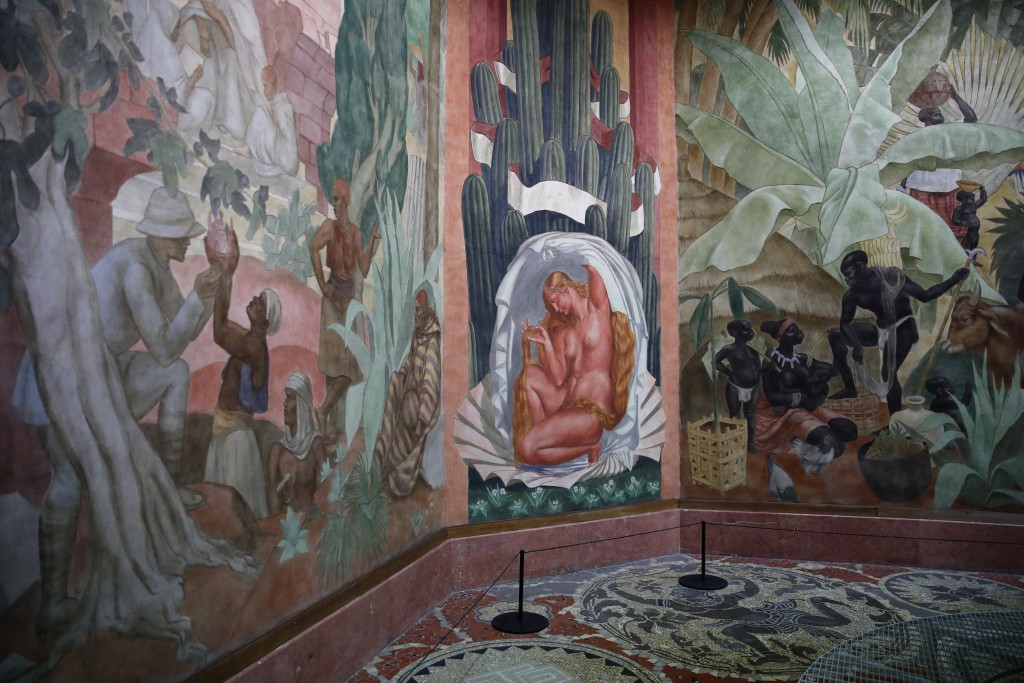 An interior view of France's National Museum of the History of Immigration showing a 1931 mural by French artist Pierre Ducos de la Haille, in Paris, ...