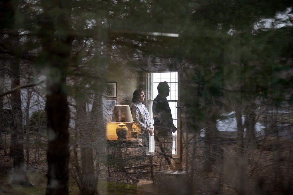 L. Shapley Bassen, left, talks with her husband, Michael, as they stand for a photo in their home in East Greenwich, R.I., Thursday, March 11, 2021. T...