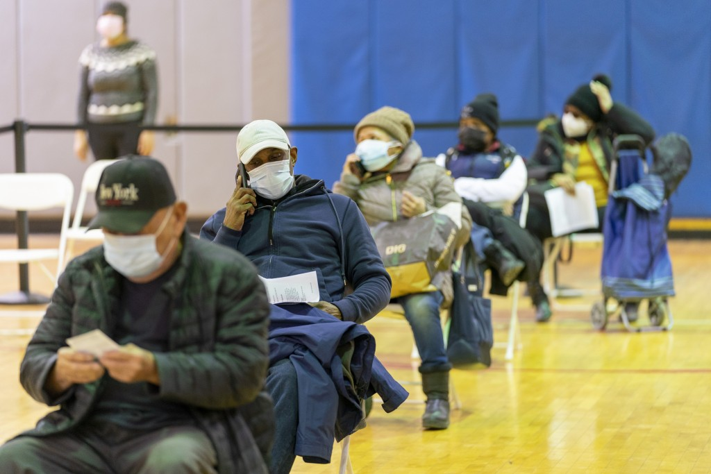 FILE - In this Jan. 31, 2021, file photo, seniors wait in the recovery area after receiving the first dose of the coronavirus vaccine at a pop-up COVI...
