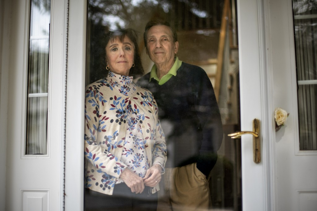 L. Shapley Bassen, left, is photographed with her husband, Michael, in their home in East Greenwich, R.I., Thursday, March 11, 2021. The road to a COV...