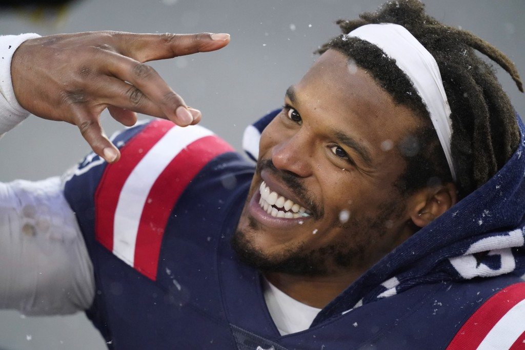 FILE - In this Jan. 3, 2021, file photo, New England Patriots quarterback Cam Newton leaves the field after an NFL football game against the New York ...