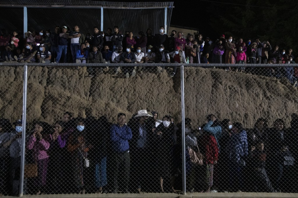 People attend a memorial Mass for the Guatemalan migrants who were killed near the U.S.-Mexico border in January, at a soccer stadium in Comitancillo,...
