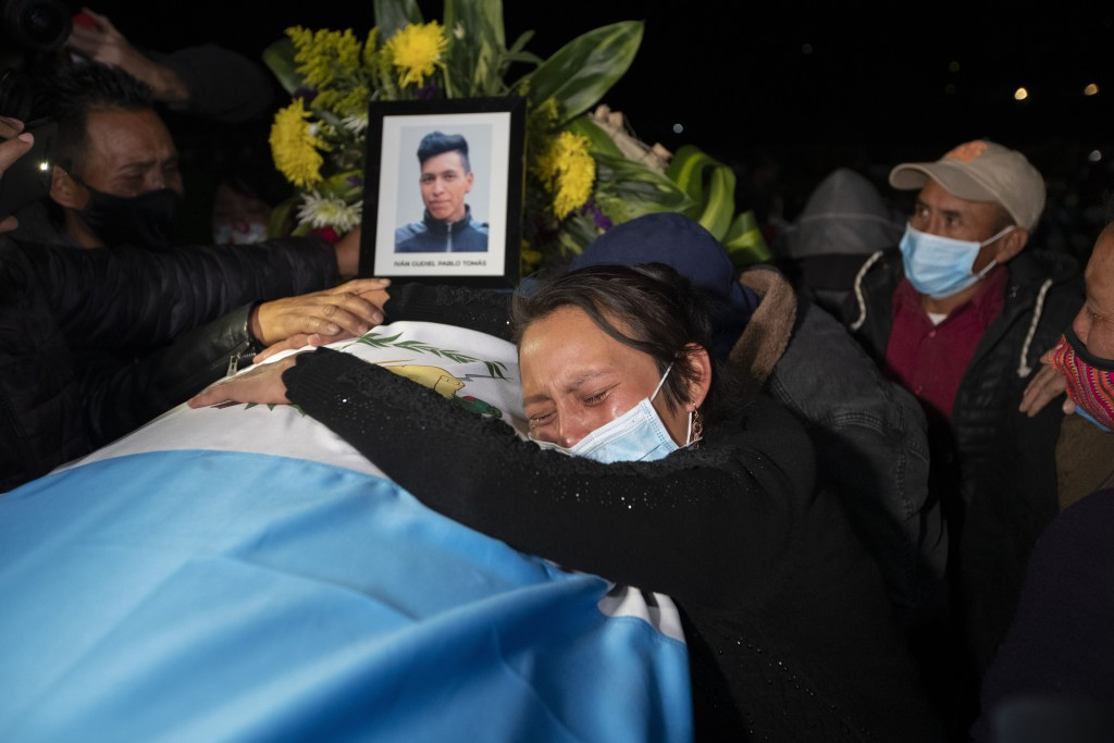 A relative grieves over the coffin containing the remains of Ivan Pablo Tomas, one of the Guatemalan migrants who was killed near the U.S.-Mexico bord...
