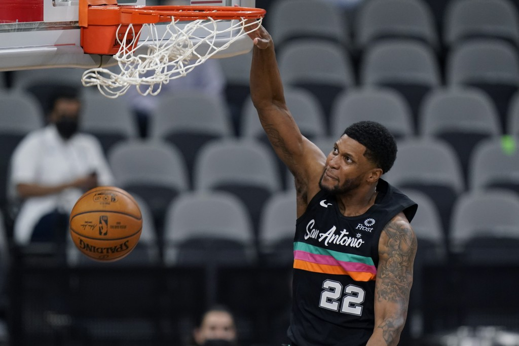 San Antonio Spurs forward Rudy Gay (22) scores against the Orlando Magic during the second half of an NBA basketball game in San Antonio, Friday, Marc...