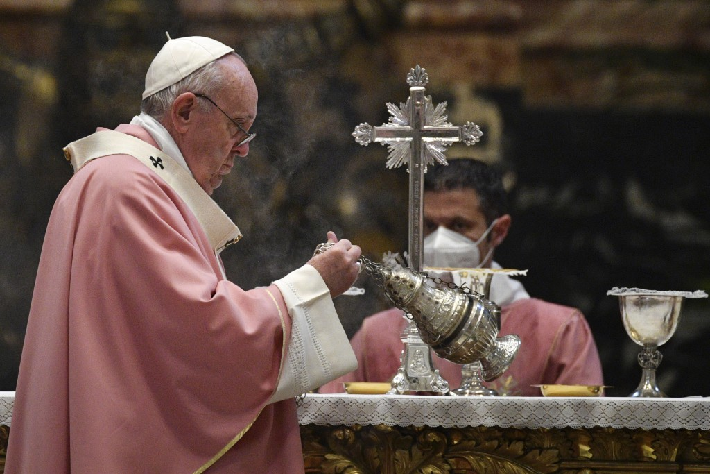 Pope Francis incenses the altar as he celebrates mass on the occasion of 500 years of Christianity in the Philippines, in St. Peter's Basilica, at the...