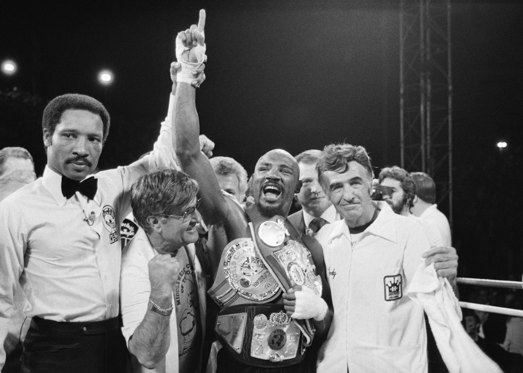 FILE - In this April 1985 file photo, middleweight champion Marvin Hagler celebrates his title with his manager, Pat Petronelli, and co-manager, Goody...