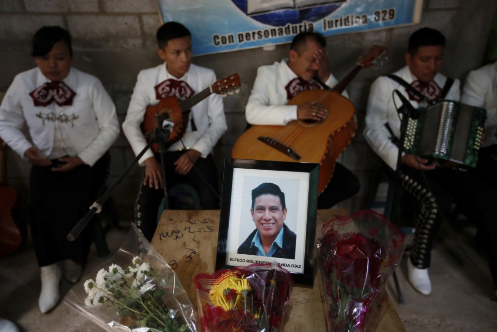 A framed portrait of Elfego Miranda Diaz, one of Guatemalan migrants who was killed near the U.S.-Mexico border in January, sits on top of the coffin ...