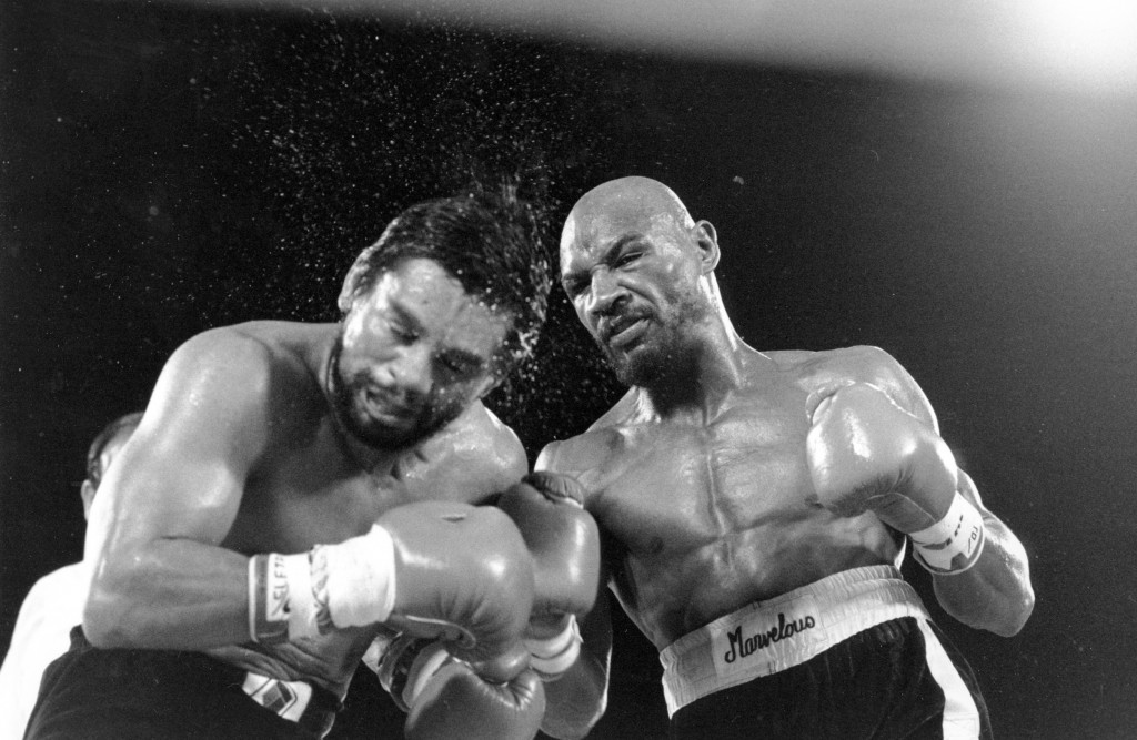 FILE - In this November 1983 file photo, Marvin Hagler sends sweat flying as he pounds challenger Roberto Duran in the ninth round of a boxing bout in...