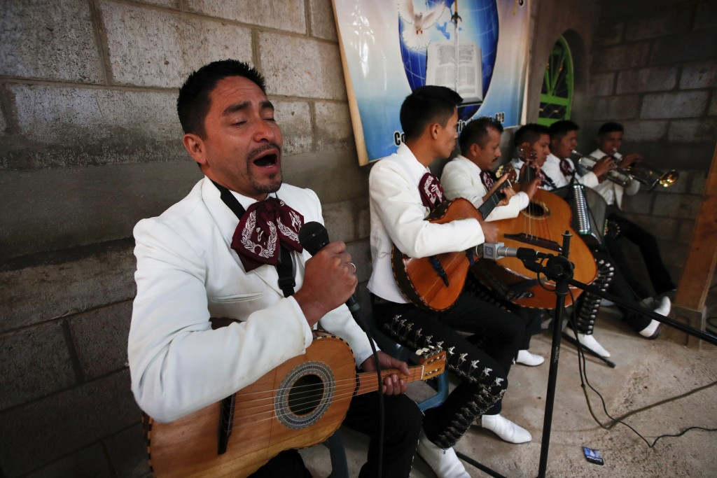 Mariachis perform at the wake celebrating the life of Elfego Miranda Diaz, one the Guatemalan migrants who was killed near the U.S.-Mexico border in J...