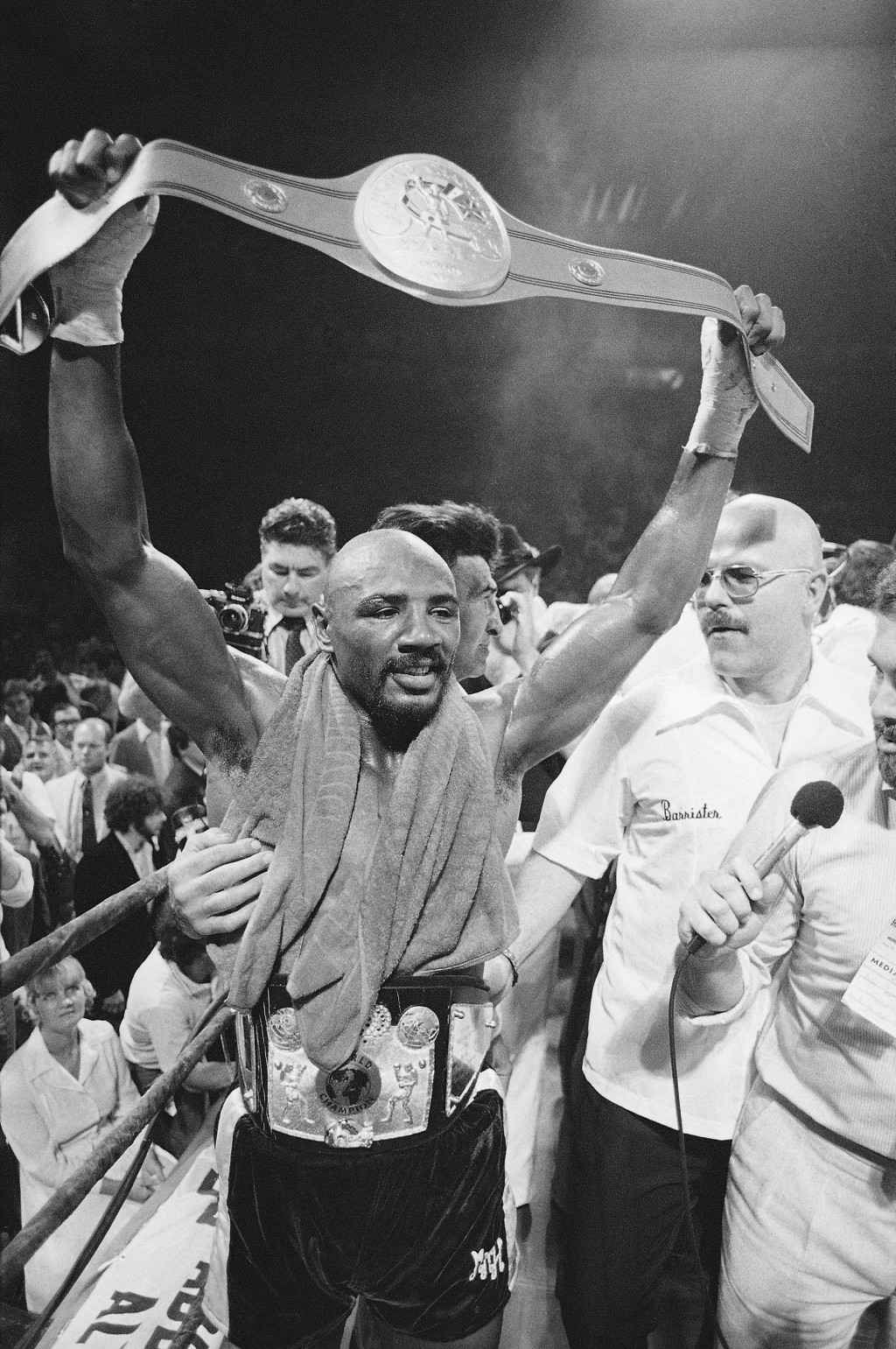 FILE - In this June 1981 file photo, middleweight champion Marvin Hagler holds the championship belt over his head after he defeated Vito Antuofermo i...