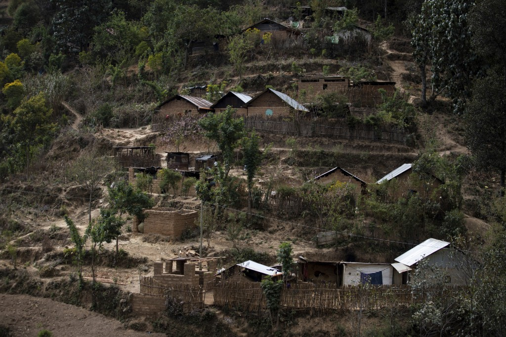 Metal roof homes dot the hilly landscape in the San Francisco community of Comitancillo, Guatemala, Saturday, March 13, 2021, where friends and family...