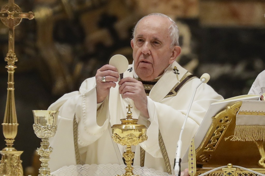 FILE -- In this Feb. 2, 2021 file photo, Pope Francis celebrates a Mass with members of religious institutions on the occasion of the celebration of t...