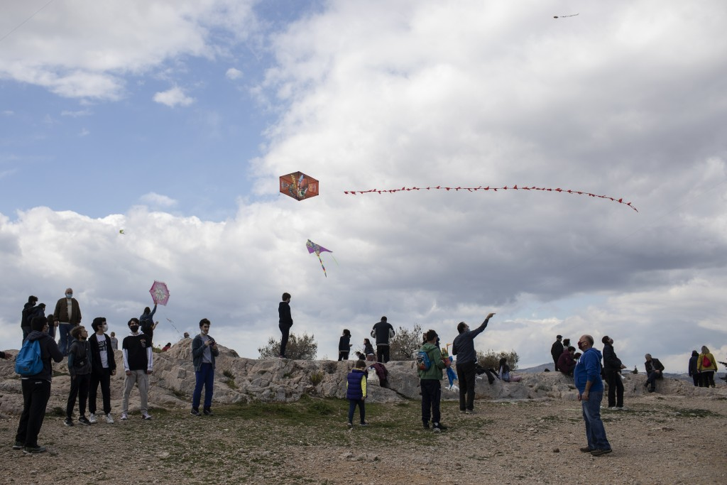 People fly kites in Filopapou hill of Athens, on clean Monday, March 15, 2021. The coronavirus pandemic, which hit Cyprus, and Greece especially hard ...