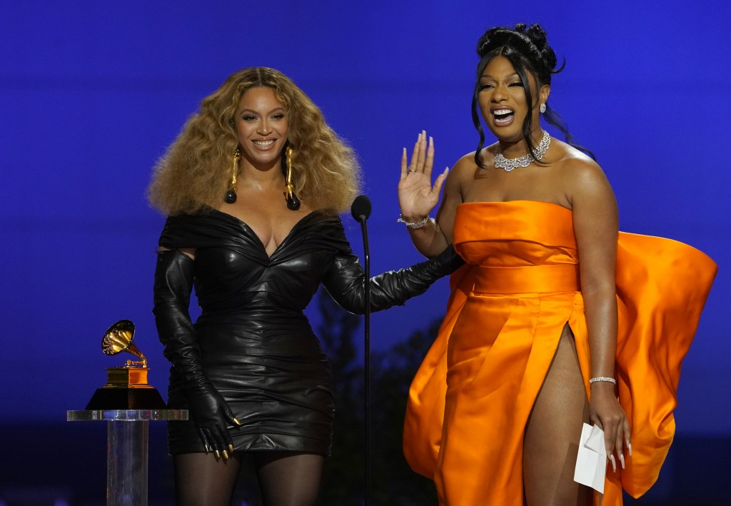 """Beyonce, left, and Megan Thee Stallion accept the award for best rap song for """"Savage"""" at the 63rd annual Grammy Awards at the Los Angeles Convention ..."""