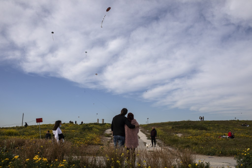 A couple flies a kite in Drapetsona suburb of Piraeus, near Athens, on Sunday, March 14, 2021. The coronavirus pandemic, which hit Cyprus, and Greece ...