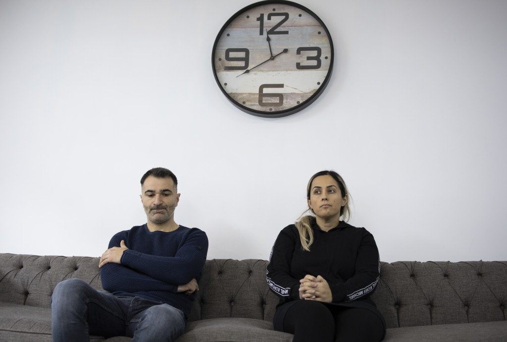35-year-old Aytec Aydin and his 33-year-old wife Nazan, pause during an interview in Tegelen, Netherlands, Tuesday, March 9, 2021. Azan Aydin and her ...